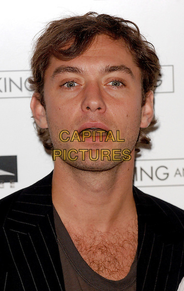 "JUDE LAW.""Breaking and Entering"" photocall, Dorchester Hotel, London, UK..October 27th, 2006.Ref: BEL.headshot portrait mouth open.www.capitalpictures.com.sales@capitalpictures.com.©Tom Belcher/Capital Pictures."