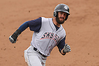 Colorado Springs Sky Sox outfielder Matt Long (12) rounds third base during a Pacific Coast League game against the Iowa Cubs on May 11th, 2015 at Principal Park in Des Moines, Iowa.  Colorado Springs defeated Iowa 13-7.  (Brad Krause/Four Seam Images)
