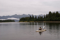 Kayak fishing for Silver salmon (Coho) in the Valdez, Alaska area of south central Alaska with Pacific Mountain Guides outfitter Otto Kulm. Fishing was done in both salt water and fresh water in the Prince William Sound region. Pat Welch kayaking for Coho at Irish Cove.