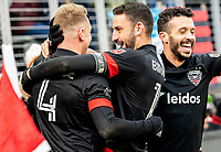 WASHINGTON, DC - FEBRUARY 29: Russell Canouse #4 after scpring celebrates with Steven Birnbaum #15 and Felipe Martins #18 of DC United during a game between Colorado Rapids and D.C. United at Audi Field on February 29, 2020 in Washington, DC.