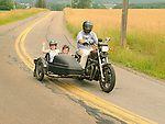 Grandfather and grandchildren in sidecar for country ride in Nippenose Valley.
