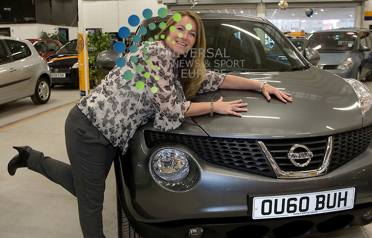 Competition winner Anne Hutton with her new Nissan Juke at the East kilbride Dealership..Picture:Universal News And Sport (Scotland) .11 December 2010..