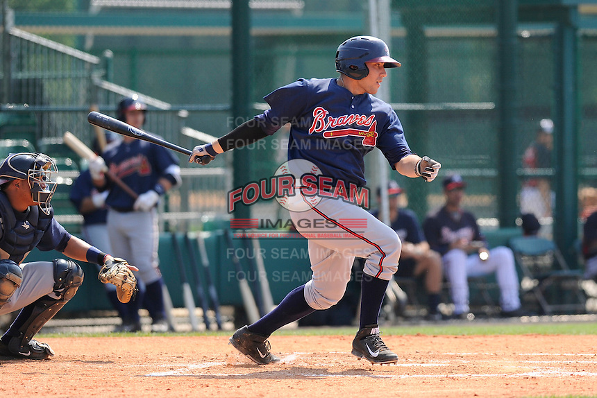 Infielder Tanner Krietemeier (62) of the Atlanta Braves farm system in a Minor League Spring Training intrasquad game on Wednesday, March 18, 2015, at the ESPN Wide World of Sports Complex in Lake Buena Vista, Florida. The catcher is Carlos Martinez. (Tom Priddy/Four Seam Images)