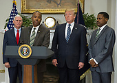 United States Secretary of Housing and Urban Development Ben Carson makes remarks prior to US President Donald J. Trump signing a proclamation to honor Dr. Martin Luther King, Jr. Day in the Roosevelt Room of the White House in Washington, DC on Friday, January 12, 2018.  From left to right: US Vice President Mike Pence, Secretary Carson, President Trump and Isaac Newton Farris, Jr., Nephew of Martin Luther King Jr.<br /> Credit: Ron Sachs / CNP
