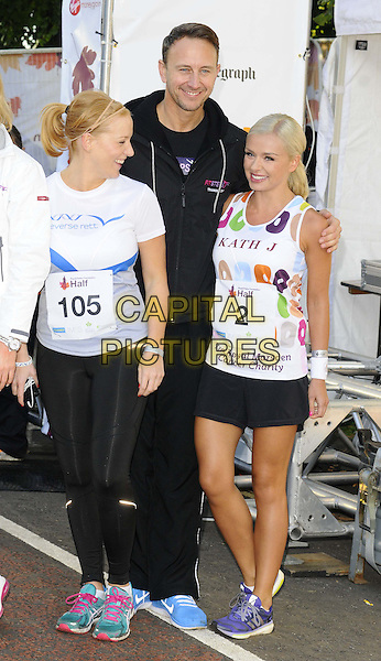 guest, Ian Waite &amp; Katherine Jenkins<br /> The Royal Parks Foundation Half Marathon, Hyde Park, London, England.<br /> October 6th, 2013<br /> full length blue shorts t-shirt white leggings profile <br /> CAP/CAN<br /> &copy;Can Nguyen/Capital Pictures