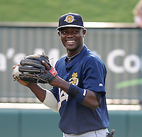 Infielder Jose Toussen (9) of the Charleston RiverDogs, Class A affiliate of the New York Yankees, prior to a game against the Greenville Drive on July 31, 2011, at Fluor Field at the West End in Greenville, South Carolina. (Tom Priddy/Four Seam Images)