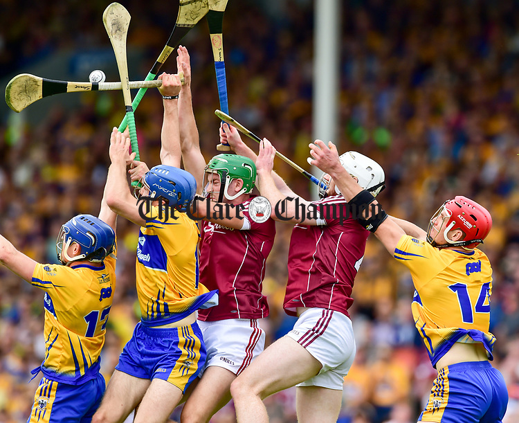 Podge Collins, Shane O Donnell, John Conlon of Clare in action against Adrian Tuohey and John Hanbury of Galway during their All-Ireland semi-final replay at Semple Stadium,Thurles. Photograph by John Kelly.