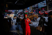 People walk along 42 street in Times Square covered with snow after the pass of the winter storm JONAS, in New York, 01/24/2016. Photo by VIEWpress