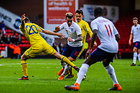 FC Shakhtar Donetsk's midfielder Oleksandr Pikhalyonok (20) for Ukraine U21's  takes the ball off Norwich City's forward James Maddison (10) for England U21's during the International Euro U21 Qualification match between England U21 and Ukraine U21 at Bramall Lane, Sheffield, England on 27 March 2018. Photo by Stephen Buckley / PRiME Media Images.