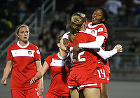BOYDS, MARYLAND - April 06, 2013:  Stephanie Ochs (22) and Tiffany McCarty (14) of The Washington Spirit after Tiffany McCarty (14) had scored against the University of Virginia women's soccer team in a NWSL (National Women's Soccer League) pre season exhibition game at Maryland Soccerplex in Boyds, Maryland on April 06. Virginia won 6-3.