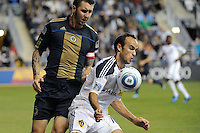 Landon Donovan (10) of the Los Angeles Galaxy plays the ball while marked by Danny Califf (4) of the Philadelphia Union. The Los Angeles Galaxy defeated the Philadelphia Union  1-0 during a Major League Soccer (MLS) match at PPL Park in Chester, PA, on October 07, 2010.