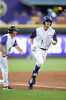 Adam Engel (7) of the Winston-Salem Dash is greeted by Winston-Salem Dash manager Tim Esmay (10) as he rounds third base following his first inning home run against the Myrtle Beach Pelicans at BB&T Ballpark on August 20, 2015 in Winston-Salem, North Carolina.  The Dash defeated the Pelicans 5-4 on a walk-off wild pitch in the bottom of the 9th inning.  (Brian Westerholt/Four Seam Images)
