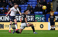 Bolton Wanderers' Craig Noone shoits under pressure from Reading's Liam Moore  <br /> <br /> Photographer Andrew Kearns/CameraSport<br /> <br /> The EFL Sky Bet Championship - Bolton Wanderers v Reading - Tuesday 29th January 2019 - University of Bolton Stadium - Bolton<br /> <br /> World Copyright © 2019 CameraSport. All rights reserved. 43 Linden Ave. Countesthorpe. Leicester. England. LE8 5PG - Tel: +44 (0) 116 277 4147 - admin@camerasport.com - www.camerasport.com