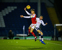 Fleetwood Town's Harrison Biggins competes in the air with Bury's Nicky Adams<br /> <br /> Photographer Alex Dodd/CameraSport<br /> <br /> The EFL Checkatrade Trophy Group B - Bury v Fleetwood Town - Tuesday 13th November 2018 - Gigg Lane - Bury<br />  <br /> World Copyright &copy; 2018 CameraSport. All rights reserved. 43 Linden Ave. Countesthorpe. Leicester. England. LE8 5PG - Tel: +44 (0) 116 277 4147 - admin@camerasport.com - www.camerasport.com