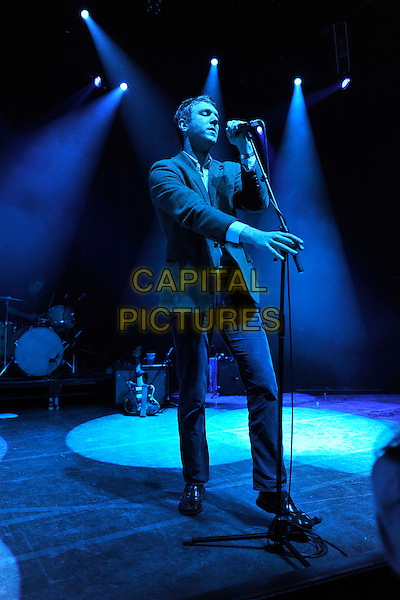 THE WALKMEN - Hamilton Leithauser .The Walkmen perform live on stage at O2 Shepherd's Bush Empire, London, England, UK, January 25th, 2011..music gig concert full length jacket microphone trousers singing .CAP/MAR.© Martin Harris/Capital Pictures.