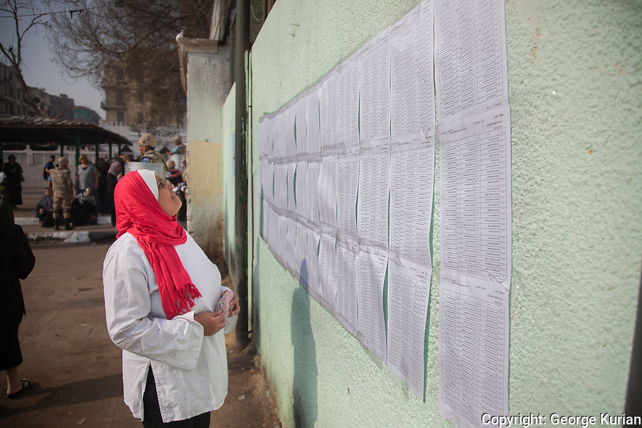 Polling station in Shubra, Cairo<br /> <br /> A woman checks to see if her name is on the voters' list, posted outside.