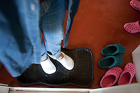 Everyone who enters the cheese processing facility must wear sanitized shoes and step in a sanitized bath before entering at the Estrella Family Creamery in Montesano, Wash. on November 4, 2010.  The Food and Drug Administration ordered the Estrella Family Creamery in Montesano,Wash.  to stop processing cheeses after it found listeria bacteria on some of the cheeses this year.  The family says they have made many renovations on the farm and the bacteria is only found on the soft cheese, not everything.  They believe they should be allowed to resume making cheese and sell the hard cheeses they have already made at the facility.  The creamery is one of Washington's most famous artisan cheesemakers.  (photo credit Karen Ducey). .