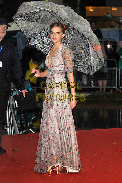 "EMMA WATSON.Arriving at the World Premiere of ""Harry Potter and the Half-Blood Prince"" at the Odeon cinema, Leicester Square, London, England, UK, July 7th 2009..Half Blood bad weather rain raining full length holding umbrella long maxi Ossie Clark dress silver grey gray print gold shiny platform shoes sandals heels open toe red black and white patterned pattern .CAP/PL.©Phil Loftus/Capital Pictures"