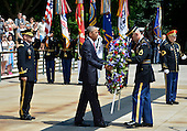 United States President Barack Obama (C) is assisted as he lays a wreath at the Tomb of the Unknown Soldier at Arlington National Cemetery, Arlington, Virginia, on Memorial Day, May 30, 2016, near Washington, DC. Obama paid tribute to the nation's military service members who have fallen.      <br /> Credit: Mike Theiler / Pool via CNP
