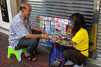 Bangkok, Thailand.  Street Vendor Selling Banknotes Showing Late King Bhumibol Adulyadej.