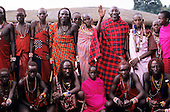 Lolgorian, Kenya. Siria Maasai; members of the Sakaja family outside their manyatta temporary house.