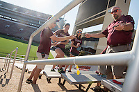 MSU Meteorology Professor Michael Brown demonstrates the installation of temperature sensors at Davis Wade Stadium to graduate students Andrew Collins, Megan Spade and Mandy Raborn. The sensors are part of a research collaboration between MSU Athletics and the Department of Geosciences. Data from the sensors will be used to improve gameday operations and better anticipate the needs of staff, athletes and fans. With high temperatures expected for Saturday's [Sept. 3] season opener against South Alabama, MSU has announced heat initiatives to ensure the safety and well-being of all fans.<br />  (photo by Megan Bean / &copy; Mississippi State University)