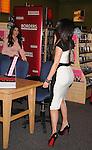 "LOS ANGELES, CA. - December 02: Kourtney Kardashian and Kim Kardashiann attend the ""Kardashian Konfidential"" Book Signing at Borders Book store on December 2, 2010 in  Century City, California."