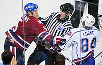 April 28, 2007; Hamilton, ON, CAN; Rochester Americans defenceman (5) Timo Helbling confronts Hamilton Bulldogs centre (84) Corey Locke during the third period of game six in the AHL north division semifinal at Copps Coliseum. The Bulldogs won 6-2 and eliminated the Americans from the playoffs. Mandatory Credit: Ron Scheffler, Special to the Spectator. (File number RRSA8540).