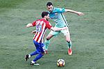 Atletico de Madrid's Yannick Ferreira Carrasco (l) and FC Barcelona's Sergio Busquets during La Liga match. February 26,2017. (ALTERPHOTOS/Acero)