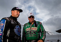 Aug 31, 2014; Clermont, IN, USA; NHRA  funny car driver John Force (right) with teammate Robert Hight during qualifying for the US Nationals at Lucas Oil Raceway. Mandatory Credit: Mark J. Rebilas-USA TODAY Sports