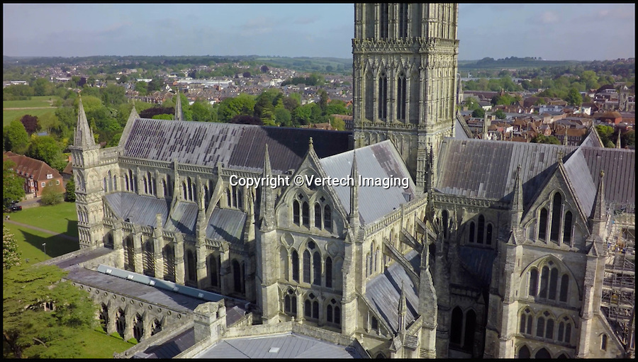 BNPS.co.uk (01202 558833)<br /> Pic: VertechImaging/BNPS<br /> <br /> These incredible images show Salisbury Cathedral like it's never been seen before - from the skies.<br /> <br /> Canny cathedral staff came up with the novel idea of using a drone to survey hard-to-reach parts of the 13th century building including its enormous 400ft spire, the tallest in Britain.<br /> <br /> Using the drone's onboard camera they were able to record high quality footage of both the outside and inside of the 795-year-old medieval building.<br /> <br /> As well as being a great help to staff, who have an ongoing battle to repair the building, the footage gives a birds-eye view of the cathedral, considered one of Britain's most important historical buildings.