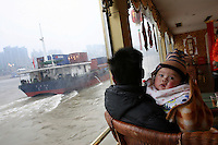 CHINA. Sichuan Province. Chongqing. A baby on a tourist boat on The Yangtze River which is at its lowest level in 150 years as a result of a country-wide drought. Chongqing is a city of over 3,000,000 people, famed for being the capital of China between 1938 and 1946 during World War II. It is situated on the banks of the Yangtze river, China's longest river and the third longest in the world. Originating in Tibet, the river flows for 3,964 miles (6,380km) through central China into the East China Sea at Shanghai.  2008.