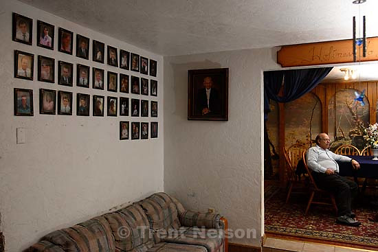Marvin Wyler in his home with portraits of his 34 children<br />
