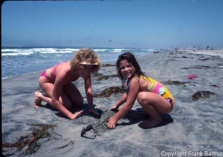 girls playing on Coronado beach
