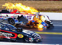Mar 18, 2018; Gainesville, FL, USA; NHRA funny car driver Robert Hight (far) explodes the engine of his car alongside Matt Hagan during the Gatornationals at Gainesville Raceway. Mandatory Credit: Mark J. Rebilas-USA TODAY Sports