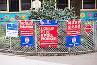 Signs for a voter registration event, with the added advantage of being hired as a poll worker, in New York on Thursday, October 13, 2016. Friday is the last day to register in order to vote in this year's presidential election.  (© Richard B. Levine)