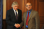 Columbia University President Lee Bollinger shakes the hand of Professor Martin Chalfie, winner of the 2008 Nobel Prize in Chemistry for the discovery and development of the green florescent protein, GFP, at a press conference announcing the award at Columbia University in New York, New York on October 8, 2008.