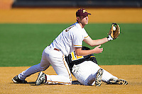 Second baseman Matt Puhl #16 of the Minnesota Golden Gophers shows the umpire the ball after tagging out Nick Natoli #12 of the Towson Tigers at Gene Hooks Field on February 26, 2011 in Winston-Salem, North Carolina.  The Gophers defeated the Tigers 6-4.  Photo by Brian Westerholt / Four Seam Images