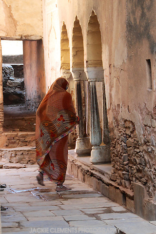 A woman dashes across a laneway in a small village in the Shekawati region of Rajasthan.