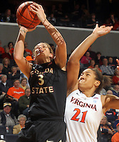 Feb. 7, 2011; Charlottesville, VA, USA; Florida State Seminoles guard Alexa Deluzio (3) shoots next to Virginia Cavaliers forward Jazmin Pitts (21) during the first half of the game at the John Paul Jones Arena.  Mandatory Credit: Andrew Shurtleff-US PRESSWIRE