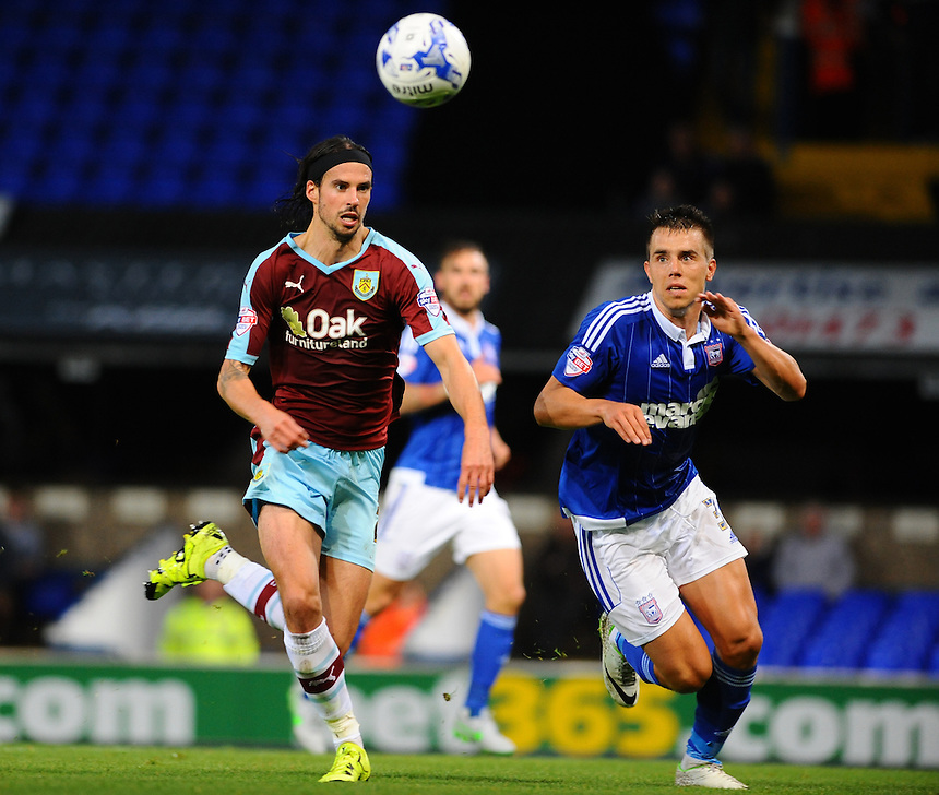 Burnley's George Boyd (L) and Ipswich Town's Jonas Knudsen keep a close eye on the ball<br /> <br /> Photographer Ashley Pickering/CameraSport<br /> <br /> Football - The Football League Sky Bet Championship - Ipswich Town v Burnley - Tuesday 18th August 2015 - Portman Road - Ipswich<br /> <br /> &copy; CameraSport - 43 Linden Ave. Countesthorpe. Leicester. England. LE8 5PG - Tel: +44 (0) 116 277 4147 - admin@camerasport.com - www.camerasport.com