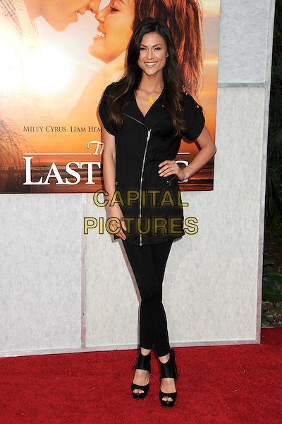 "LISA MAY .""The Last Song"" World Premiere held at Arclight Cinemas, Hollywood, California, USA, 25th March 2010..arrivals full length black zip up dress hand on hip shoes open toe platform booties leggings .CAP/ADM/BP.©Byron Purvis/AdMedia/Capital Pictures."