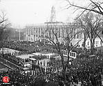 when Waterbury's 102nd Infantry of the famed Yankee Division of World War I returned home in 1919, it found a city waiting to pay its respects to both those who came back and those who made the supreme sacrifice. On May 4, 1919, impressive ceremonies marked the dedication of an Honor Roll monuments. The dedication was attended by Gov. Marcus H. Holcomb, Mayor William H. Sandland, and the rev. Dr. John N. Lewis and the REv. Eugene P Cryne (Pastor of St. Patrick's Church). Each gave stirring addresses. State and City Guards formed a hollow suare inside of which were grouped officers and men of the 102nd Infantry. A volley was fired over the new Honor Roll. Miss Mary Coyle, a sister ofWaterbury's first casualty of World War I, Cpl. Frank Coyle, after whom the local American Legion Post was named, laid a wreath at the base of the monument. The bell in the old railroad station tower (the current Republican-American building)tolled once every 30 seconds to commemorate the death of the 136 soldiers, whose names were inscribed on the roll at the dedication. Later, more names were added. The roll also included names of all Waterbury men who were called into service from the time of the U.S. etnry into World War I from April 1917, until the Armistice of Nov. 11, 1918. the Honor Roll was moved from its original location when the driveway between City Hall and Bronson Library was designed. At that time, it was placed at a point opposite the railroad station. Its next move was just west of the library building, where the wooden framework slowly disintegrated. It was razed as work started on the library addition. The bronze name plates were zaved and placed in the lobby of City Hall.