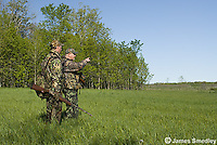 Two men hunting wild turkey
