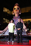 "April 26, 2018, Tokyo, Japan - Japanese contemporary artist Kenji Yanobe (R) and art director Sebastian Masuda display a 4-meter tall statue ""Flora"" at the opening of Hibiya Festival to celebrate for the opening of Tokyo's new landmark Tokyo Midtown Hibiya on Thursday, April 26, 2018. ""Flora"", produced by Yanobe is installed at the forecourt of the shoppoing mall through may 20.   (Photo by Yoshio Tsunoda/AFLO) LWX -ytd-"