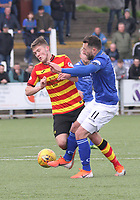 Stephen Dobbie gets a foot to the ball before Blair Spittal in the SPFL Ladbrokes Championship football match between Queen of the South and Partick Thistle at Palmerston Park, Dumfries on  4.5.19.
