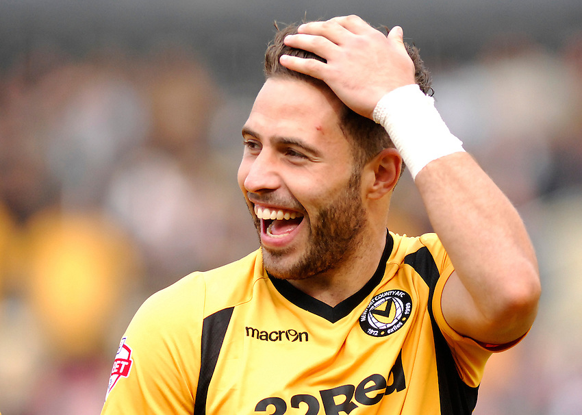 Newport County's Robbie Willmott in action during todays match  <br /> <br /> Photo by Ashley Crowden/CameraSport<br /> <br /> Football - The Football League Sky Bet League Two - Newport County v Torquay United - Saturday 28th September 2013 - Rodney Parade - Newport<br /> <br /> &copy; CameraSport - 43 Linden Ave. Countesthorpe. Leicester. England. LE8 5PG - Tel: +44 (0) 116 277 4147 - admin@camerasport.com - www.camerasport.com