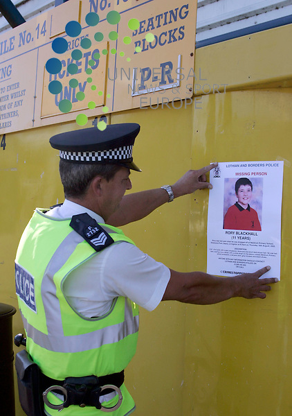 Pic Maurice McDonald. 20 August 2005. .Lothian and Borders Police handing out flyer with the missing 11 year old boy Rory Blackhall before the Scottish Premierleauge,  Livingston FC v Dunfermline FC  at Amondvale Stadium.