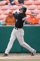 Evan Ocheltree #4 of the Wake Forest Demon Deacons follows through on his swing versus the Clemson Tigers at Doug Kingsmore stadium March 13, 2009 in Clemson, SC. (Photo by Brian Westerholt / Four Seam Images)