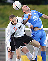City's Ross Guthrie and Queen of the South's Derek Lyle challenge for the ball ...